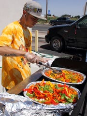 Peppers Supermarket celebrated its 21st anniversary on Saturday, June 17, as Deming's home-owned and operated grocer. The Hereford Beef staff served up rib-eye steak sandwiches to customers that were topped off with delicious grilled peppers. Peppers People (employees) made customers comfortable under a shade canopy while KOTS Radio personality Danny Rodriguez provided music and a live remote.