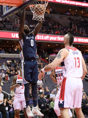 Memphis Grizzlies forward JaMychal Green (0) dunks over Washington Wizards center Marcin Gortat (13), of Poland, during the first half of an NBA basketball game, Wednesday, Dec. 13, 2017, in Washington. (AP Photo/Nick Wass)