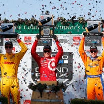 Scott Dixon (c) of New Zealand, driver of the #9 Target Chip Ganassi Racing Chevrolet Dallara celebrates winning the Verizon IndyCar Series GoPro Grand Prix of Sonoma at Sonoma Raceway on Aug. 30, 2015 in Sonoma, Calif.