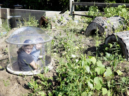 Jessica Larsen, 16, and Wyatt Humphrey, 4, of Green Bay explore the NEW Zoo's prairie dog enclosure from a new pop-up observation area.