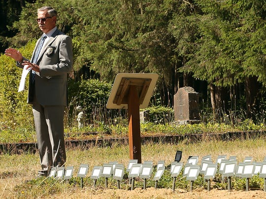 Kitsap County Coroner ​​Greg Sandstrom addresses those in attendance for the burial ceremony on Friday.