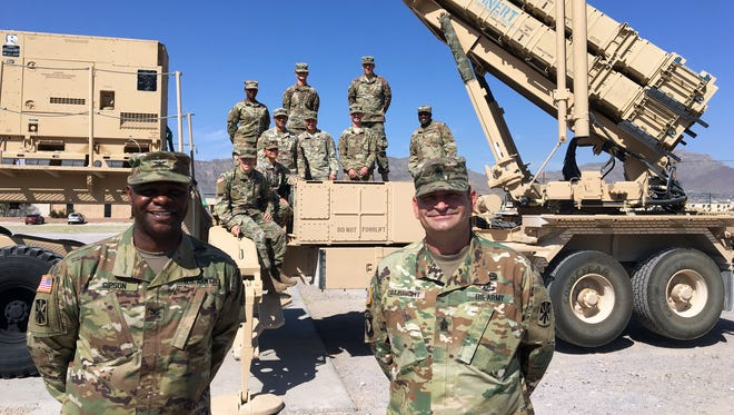 """Col. Issac """"Ike"""" Gipson, left, and Command Sgt. Maj. Paul Albright are the command team for the 11th Air Defense Artillery Brigade. They will lead a headquarters element on a deployment to the Middle East. Here, they stand with a Patriot launcher and some soldiers from the brigade."""