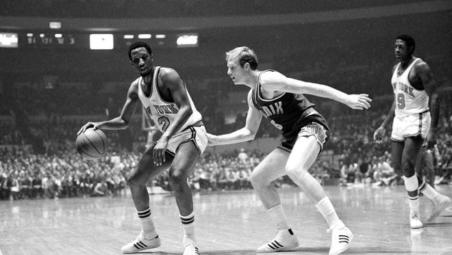 Dick van Arsdale (right) of the Phoenix Suns comes in on the play from behind as New York Knicks' Dick Barnett prepares to move out with the ball in their game at New York's Madison Square Garden, Oct. 21, 1969.