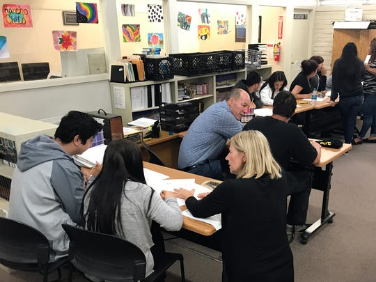 Mary Wootton, lower right, works with students at Rancho Cielo Youth Campus