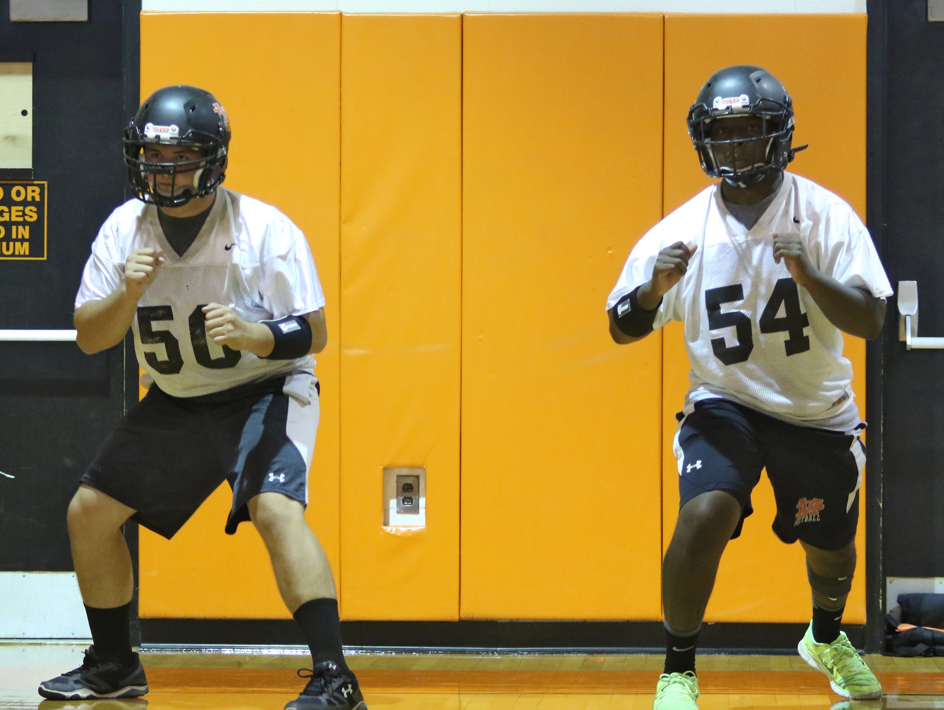 Marlboro High School's, from left, Josh Jennison, and Tayo Akinboboye during a drill at football practice on Wednesday.