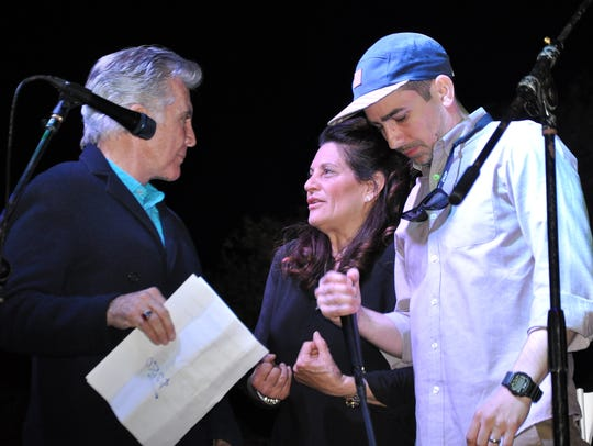 """""""The Hunt"""" host John Walsh and his son, Cal, talk to Grind & Grape owner Barbaralee Monday in 2017  before a live auction to raise money for Andy Capak, who was shot outside a bar in downtown Vero Beach."""