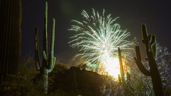 Fireworks from Harold's Corral light up the desert in Cave Creek, Arizona on Monday, July 3, 2017.