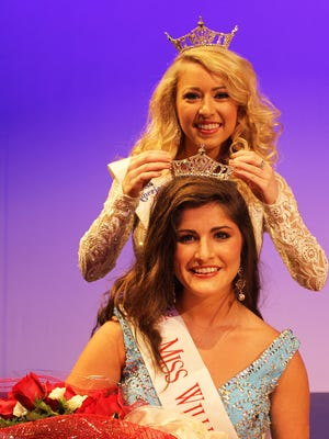 Madison Peyton of Hattiesburg is crowned Miss William Carey University 2016 by Katie Sims of Purvis, Miss WCU 2015, during the annual scholarship pageant on Nov. 19. Peyton will go on to compete in the Miss Mississippi Pageant in Vicksburg on June 25.