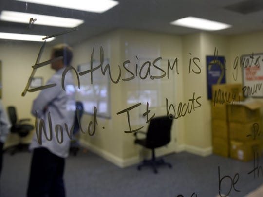 Brandon Bruce, co-founder & COO of Cirrus Insight talks to a reporter in the background of one of their slogans written on a window Wednesday, August 24, 2016. Cirrus Insight is the first application to connect Gmail with Salesforce. The company is one of the top 50 fastest growing private companies in the country. (MICHAEL PATRICK/NEWS SENTINEL)