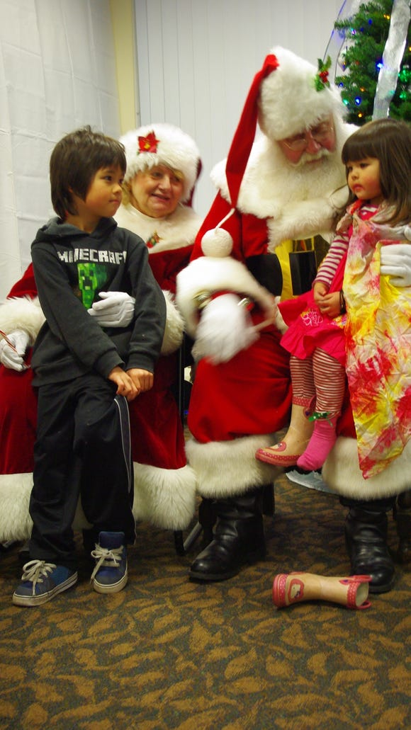 Santa and Mrs. Claus chat with Taiga and Misha Tani at Village Hall.  (Photo: M. Rosenberry)