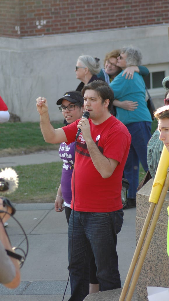 Metro Justice's Colin O'Malley speaks to the crowd.