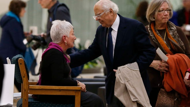 Trudy Holman Hurd, wife of past Principal CEO Dave Hurd, is greeted by hundreds of friends and colleagues during a memorial service at Capitol Square on Tuesday, Feb. 16, 2016, in Des Moines.