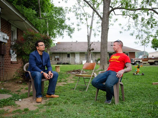 Heval Kelli and Chris Buckley talk in Buckley's yard. Arno Michaelis, a recovered Nazi skinhead-turned-Buddhist who had helped Buckley leave the Klan, arranged for their meeting.