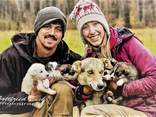 636552526029323492-Shaynee-and-husband-with-dogs.jpg