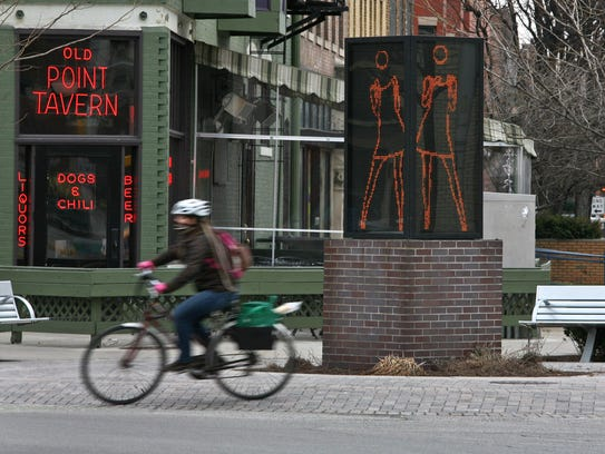 "A bicyclist rides past ""Ann Dancing"" at the intersection of Massachusetts Avenue, Vermont and Alabama Streets, on the Cultural Trail, Thursday, February 9, 2012.  Kelly Wilkinson / The Star"