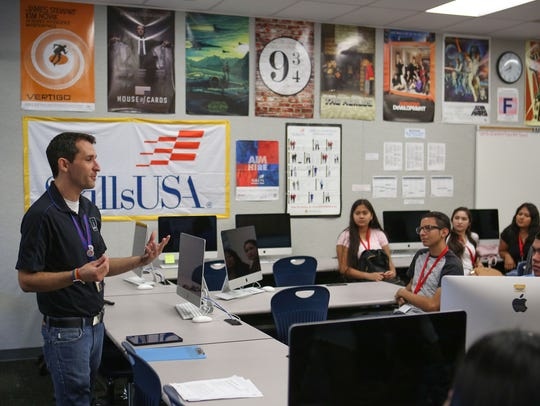Teacher Tom Buck talks with his class during the first