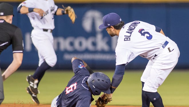 Shortstop Blake Trahan (32) tries to help the umpire make the call as second baseman Alex Blandino (5) tags out Alex Glenn (6) trying to steal second during the Jacksonville Jumbo Shrimp vs Pensacola Blue Wahoos baseball game in Pensacola on Tuesday, April 18, 2017.