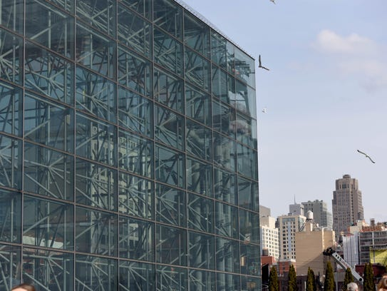 Javits Center  replaced 6,000 window panels with less