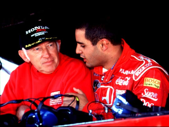Engineer Morris Nunn (left) went over the chassis setup with Juan Pablo Montoya at Nazareth Speedway.