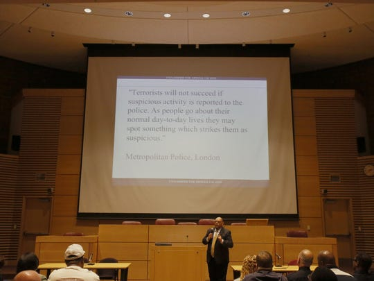 Al Shenouda, Protective Security Adviser, Department of Homeland Security, talks about reporting suspicious activity and other issues at the training summit on security at houses of worship on Monday at Wayne State.