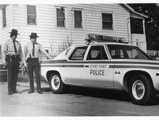 One of the original Stony Point police cars and officers
