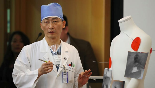 South Korean doctor Lee Cook-Jong, who carried out surgery on gunshot wounds sustained by a North Korean soldier, speaks about the condition of the soldier during a briefing at Ajou University Hospital in Suwon, south of Seoul, on Nov. 15, 2017.