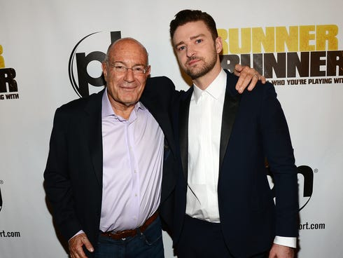 Regency Chairman Arnon Milchan, left, and singer/actor Justin Timberlake arrive at the world premiere of Twentieth Century Fox and New Regency's film