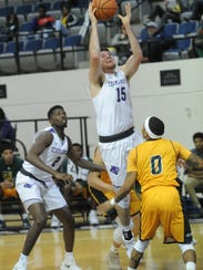 ACU's Hayden Farquhar (15) drives to the basket as