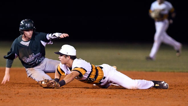 Merritt Island's Brady McConnell forces out Melbourne baserunner Logan Kraus for the double play during Wednesday's game.
