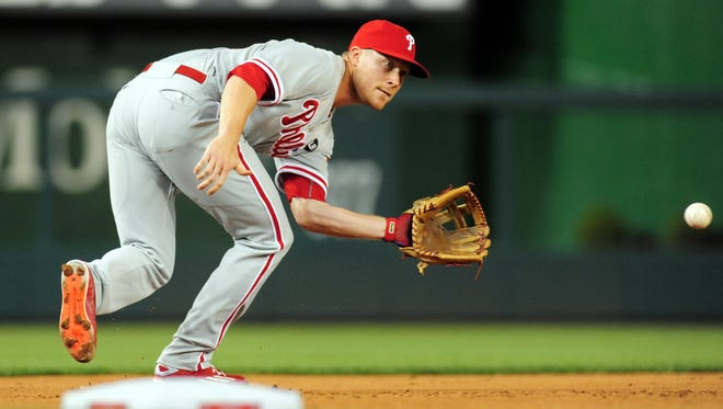 Third baseman Cody Asche was optioned to Triple-A Lehigh Valley Monday night, where he will start playing left field.