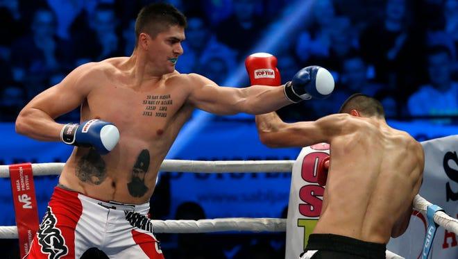 Former Detroit Pistons player Darko Milicic, left, fights against Radovan Radojcin during their kickboxing match at the Soul Night of Champions in Novi Sad, Serbia, on Thursday, Dec. 18, 2014.
