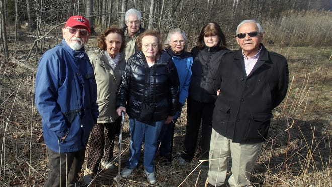 From left, Constantine Gledsos, Joni Anger, Richard Sumner, Marilyn Klass, Doris Sherwood and Pearl and Paul Georgiou, all Pomona residents, on April 17. The group is among a number of residents who are in support of the village defending itself in the lawsuit filed by the Congregation Rabbinical College of Tartikov. They say they want the village to defend its zoning laws to maintain its rural character.