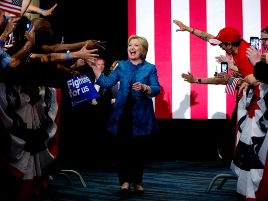Hillary Clinton arrives to a cheering crowd in West