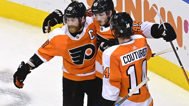 The Flyers', from left, Claude Giroux, Joel Farabee and Sean Couturier celebrate Farabee's second-period goal against the Canadiens on Wednesday night.