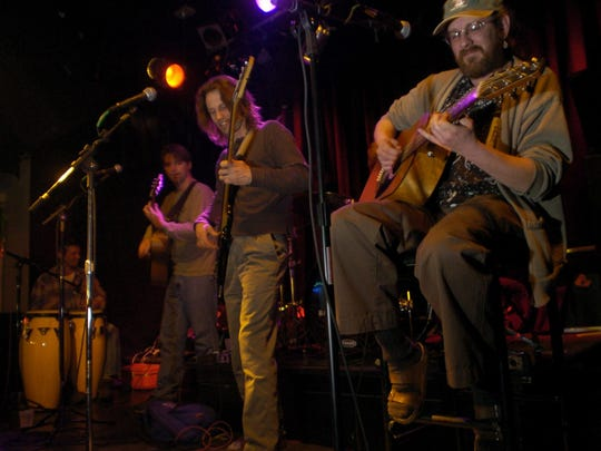 (From right) Muggsy Lauer, Jeff Engholm and Nathan Nesje of Collective Unconscious play in 2002, not too long after the band formed. The band is celebrating its 15th anniversary.
