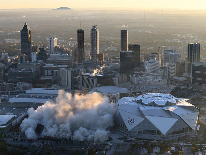 The Georgia Dome is destroyed in a scheduled implosion