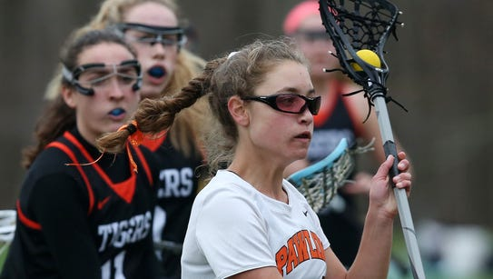 Pawling's Kiera Tucci (14) fires a shot for a first