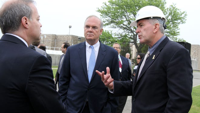 (center) DEP Commissioner Bob Martin speaks to (left) David Zimmer, executive director of NJ Environmental Infrastructure Trust, and (right) Robert Fischer, executive director of Bayshore Regional Sewerage Authority, during the groundbreaking ceremony for a $28 million project to rebuild the Sandy-damaged facilities at the Bayshore Regional Sewerage Authority in Union Beach, NJ Monday May 18, 2015.