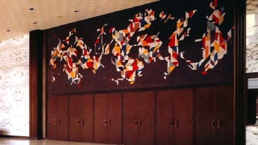 """The ceramic tile mural, titled """"Space Walk,"""" was installed in 1970 when the convention center was built. Harper designed it – using graph paper to map out individual ceramic tiles – specifically for the center. It is one of the only non-representational – or abstract – images Harper created."""
