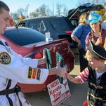 The Pleasant Hill community hosted a family friendly Trunk or Treat activities Sunday afternoon at the Orange Planet parking lot. Area business offered treats and fun things to do for kids and parents. Zion McCool, 6, as a pirate kid tries out the martial arts with Logan Sanders who own a martial arts business in Pleasant Hill.