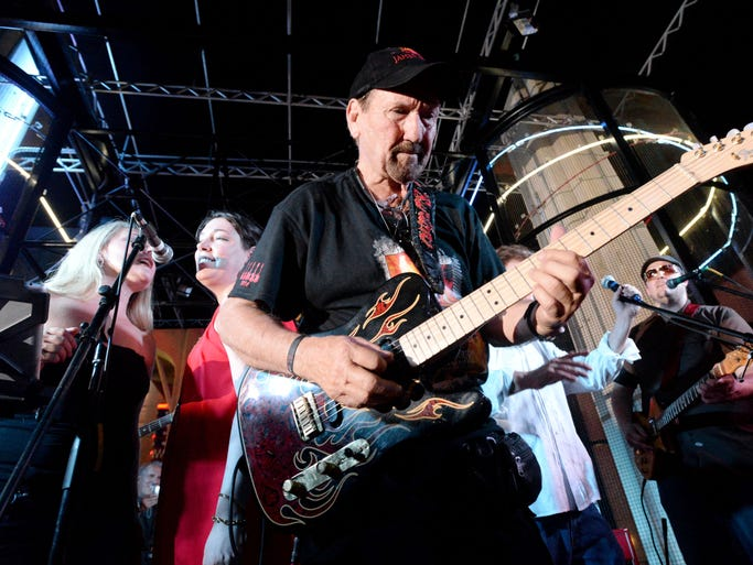 "James Burton plays his guitar during the James Burton International Guitar Festival kick off with ""Cheers to 75 Years! James Burton's Birthday celebration"" Friday evening at the Red River District."