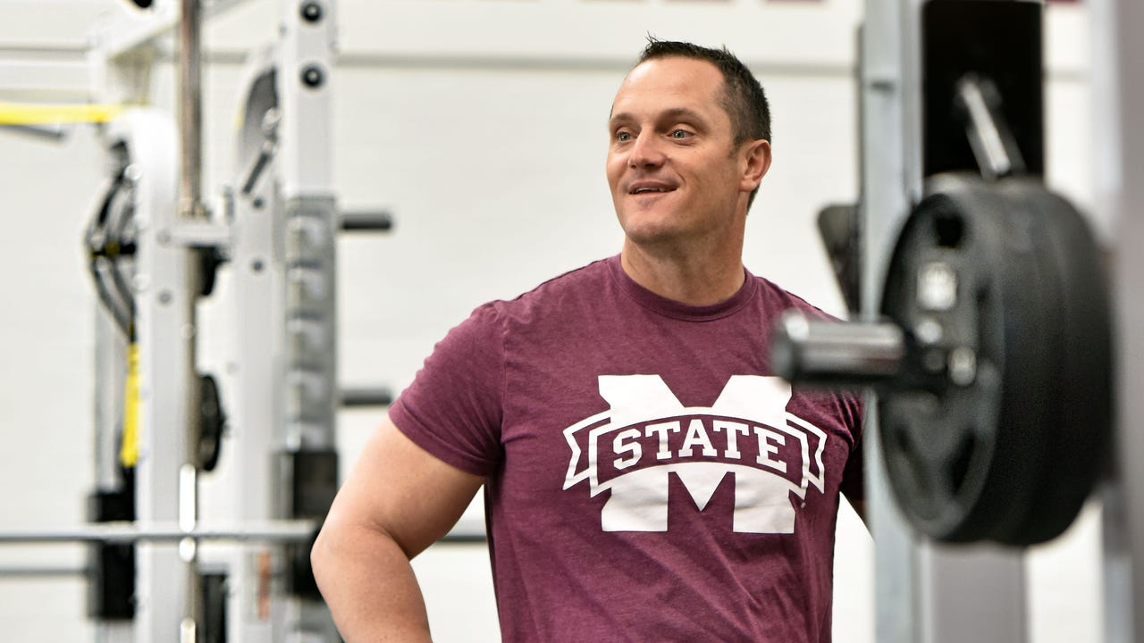 The new Mississippi State University baseball coach Andy Cannizaro is interviewed by The Clarion-Ledger sports writer Will Sammon while they work out with and strength coach Brian Neal at MSU.