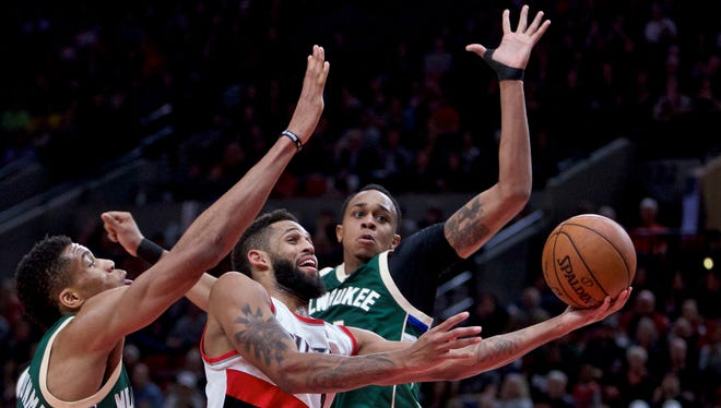 Giannis Antetokounmpo (left) and John Henson helped protect the rim in a win over Trail Blazers on Tuesday night.