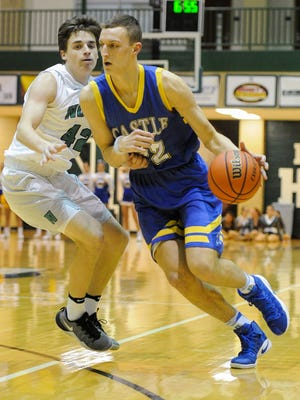 Castle's Jack Nunge (22) drives past North's Kade Fleming (42) during their game at North High School, Tuesday, Feb. 7, 2017. Castle beat North 102-54.