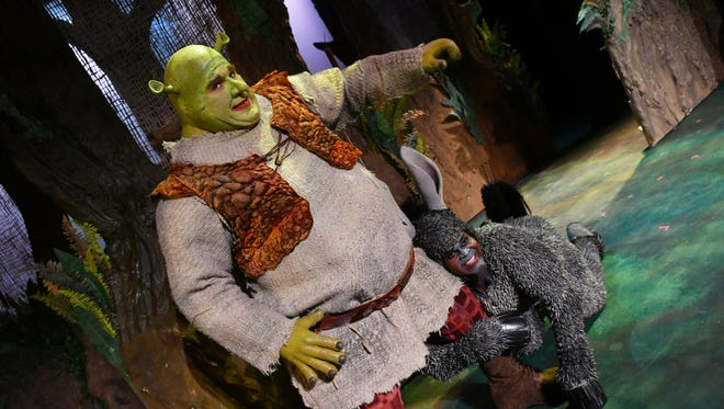 """Joe Tokarz as """"Shrek"""", and Sterling Lovett as """"Donkey"""". Dreamworks """"Shrek The Musical"""" will be presented at the Titusville Playhouse August 18-Sept.10. For tickets, call (321) 268-1125 ir visit www.TitusvillePlayhouse.com."""