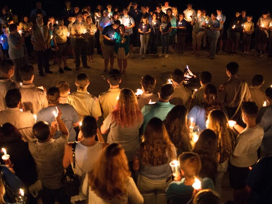 Family, friends and community members gather for a candlelight vigil, sharing personal memories and honoring the life of Shayden Colvin at the Fire Training Center in North Naples on Wednesday, Nov. 15, 2017.