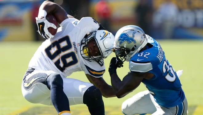 San Diego Chargers tight end Ladarius Green slips away from Detroit Lions strong safety James Ihedigbo, right, on Sunday, Sept. 13, 2015, in San Diego.