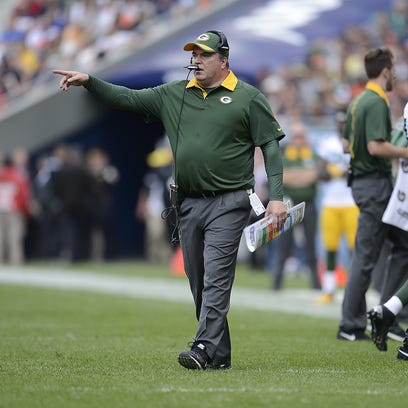 Green Bay Packers coach Mike McCarthy reacts on the