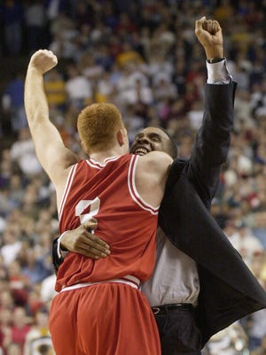 3-21-02 Slug: iubb22.#68108 Star staff photo by Rob Goebel-LEXINGTON, KY-Photo for the files from IU's win over Duke today. IN THIS PHOTO: Celebration at end of game. Tom Coverdale and Mike Davis celebrate.
