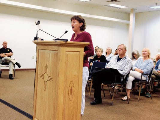 Silver City resident Janet Wallett-Ortiz speaks about PNM's proposed San Juan Generating Station plans on Tuesday during the Town Council meeting. Randal Seyler - Sun-News